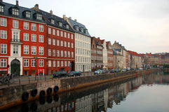 Copenhagen with its canals, boats and colorful buildings, Denmark Stock Photos