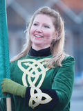 Participants at st. patrick's day parade. COPENHAGEN - MAR 17: Woman participant in green costume at the annual St. Patrick's Day celebration and parade in front Royalty Free Stock Images