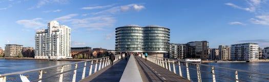 Copenhagen modern cyclist bridge. Copenhagen, Denmark - September 23, 2016: Modern cyclist bridge Bryggybroen and the Gemini Residence Royalty Free Stock Photography