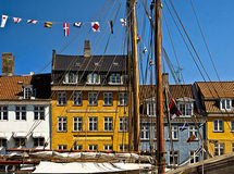 Copenhagen, Nyhavn, antique houses with bright colorful facades and old ships moored Royalty Free Stock Photos