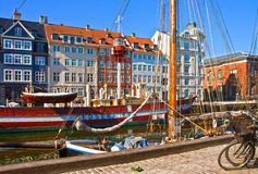 Copenhagen, Nyhavn harbor famous touristic landmark. Copenhagen, sunny view of Nyhavn harbor famous touristic landmark built in 17th-century flanked by antique royalty free stock photography
