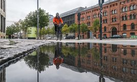 Copenhagen - October 23, 2016: A reflection of an elderly man riding a bicycle. Copenhagen - October 23, 2016:  A reflection of an elderly man riding a bicycle Stock Image