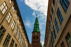 Copenhagen old town and copper spiel of Nikolaj Church royalty free stock image