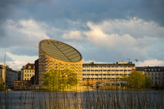 Copenhagen Planetarium. The sliced-cylinder building that houses Copenhagen's planetarium, under the afternoon sun. The picture was taken from across its stock photography