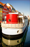 Copenhagen - 1920s style ship at Nyhavn canal. Boat in 1920's style, at the canal of Nyhavn in Copenhagen, Denmark. This vertical image combines saturated Stock Photography