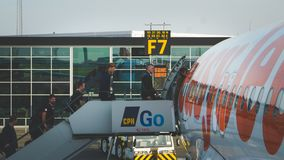 Passengers of EasyJet airline enter the airplane Stock Image