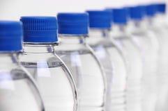 Coperchi della bottiglia di acqua Fotografie Stock