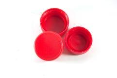 Coperchi a vite di plastica rossi della bottiglia Fotografie Stock Libere da Diritti