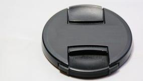 Coperchietto obiettivo isolato su colore bianco 24-70mm del nero del fondo Immagini Stock
