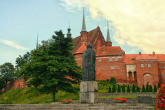 Copernicus statue. Walls behind Frombork Cathedral, place where Nicolaus Copernicus was buried. Statue of the astronomer. Poland Royalty Free Stock Photo