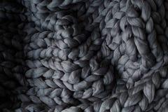 Coperta tricottata gray del primo piano, fondo della lana merino immagine stock libera da diritti