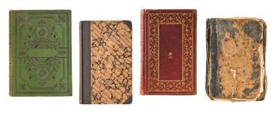 Copertina di libro d'annata di quattro vecchi libri isolata su fondo bianco fotografie stock