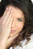 Copertura della donna il suo fronte Fotografie Stock