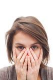 Copertura della donna il suo fronte con le mani Immagine Stock Libera da Diritti