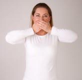 Copertura della donna la sua bocca Immagini Stock Libere da Diritti