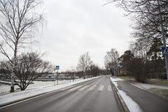 Copertura della strada da neve Immagini Stock