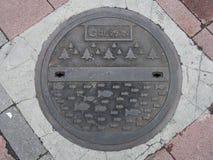 Copertura dello scolo della botola sulla via in Taipei, Taiwan Fotografia Stock Libera da Diritti