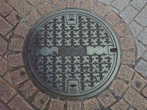 Copertura di botola di Shibuya - Tokyo, Giappone Immagine Stock
