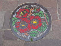 Copertura di botola in Kumamoto, Giappone Immagini Stock