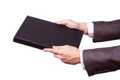 Copertura di Hand Showing Book dell'uomo d'affari Immagine Stock
