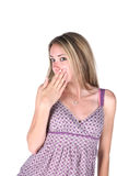 Copertura teenager sveglia la sua bocca fotografia stock