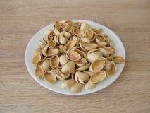 Coperture dei pistacchi per elaborare Immagini Stock