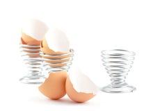 Coperture dell'uovo e portauova vuoti Immagine Stock