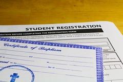 Copia del certificato battesimale obbligatoria per assistere alle scuole cattoliche fotografia stock libera da diritti