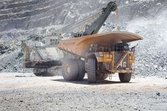 Huge dump trucks in an open pit Copper mine Royalty Free Stock Photography