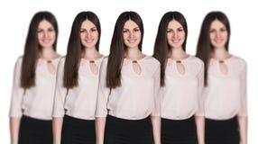 Copias de las mujeres que se colocan en fila fotos de archivo libres de regalías