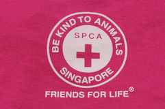 Copie de logo de T-shirt de Singapour SPCA Images stock
