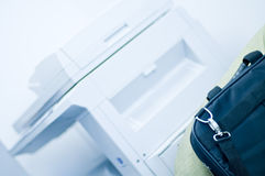 Copier & Briefcase Royalty Free Stock Photography