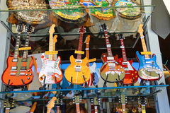 Copies of famous musicians guitars are sold at the gift shop in Royalty Free Stock Photo