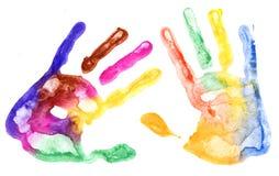 Copies multicolores de main sur le blanc Photographie stock