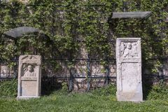Two stones with reliefs from the Roman Empire era. Remnants of the reliefs from the Roman Empire era at public park royalty free stock images