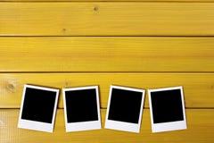 Copies vides de photo sur une table Photo libre de droits