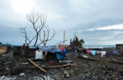 Coping with disaster. Temporary slum hut amidst the charcoaled remains of Mangagoy (Bislig City, Mindanao, Philippines) after a blazing fire destroyed half of Royalty Free Stock Photography