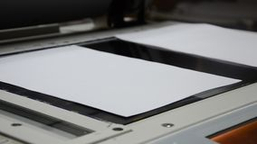 Coping a document on a photocopier Stock Photo