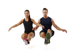 Cople doing one leg squat royalty free stock photography