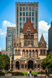 Copley Square in Boston. Copley Square in the Back Bay quarter of Boston, USA with towering buildings dwarfing people walking by Royalty Free Stock Image
