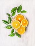 Copmosing with sliced ​​oranges and  leaves Royalty Free Stock Images