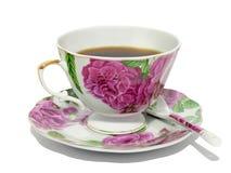 Copo ao chá, ao saucer e a uma colher Imagens de Stock