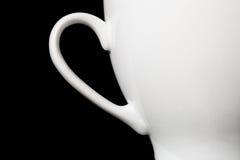 Copo branco no fundo preto Imagens de Stock Royalty Free