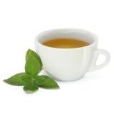 Copo com chá da hortelã Foto de Stock Royalty Free