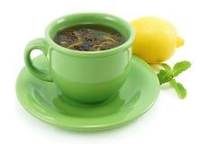 Copo com chá verde. Imagens de Stock Royalty Free