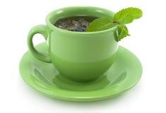 Copo com chá verde com hortelã. Imagens de Stock