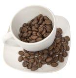 Copo com feijões do coffe imagens de stock