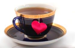 Copo com uma sombra sob a forma do coração e de um coração em uma linha Fotos de Stock