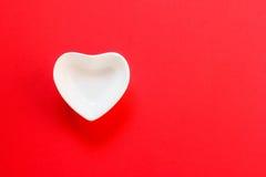 Copo da forma do coração Fotografia de Stock Royalty Free