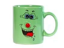 Copo de café com sorrir forçadamente fotografia de stock